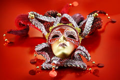 Carnival mask on red background Royalty Free Stock Photography