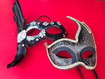 Carnival mask on red background. Two beautiful carnival mask lying on red background Royalty Free Stock Image