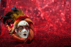Carnival mask on red blur background. Carnival mask isolated on red blur background Royalty Free Stock Image