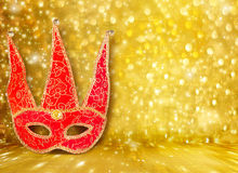 Carnival mask and a red Christmas ball Stock Image