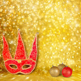 Carnival mask and a red Christmas ball Royalty Free Stock Photography