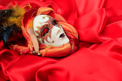 Carnival mask on red satin background. Carnival mask isolated on red satin background Stock Photography