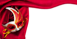 Carnival mask and red silk fabric Stock Images