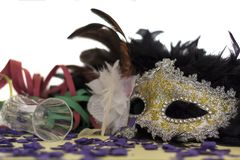 Carnival Mask, Serpentines, Confetti and champagne glass. Party Celebration concept.  stock photography