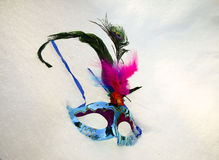 Carnival mask on snow Royalty Free Stock Image
