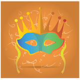 Carnival Mask. Carnival mask with some ornaments on an orange background Royalty Free Stock Images