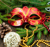 Carnival mask, spruce branches, beads Royalty Free Stock Image