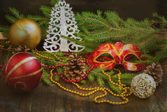 Carnival mask, spruce branches, beads. New Year card Royalty Free Stock Images