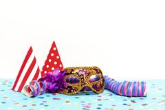 A carnival mask. With two carnival hats Royalty Free Stock Photo