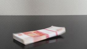 Stack of Euro banknotes and the bundle of banknotes rubles fall stock footage