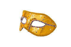 Carnival mask on white. Gold carnival mask isolated on white Stock Image