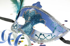 Carnival mask on white. Venetian carnival mask with confetti on white Royalty Free Stock Images