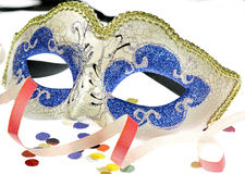 Carnival mask on white. Venetian carnival mask with confetti on white background Royalty Free Stock Photo