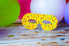 Carnival mask on white wooden background. Copyspace.  Royalty Free Stock Photos