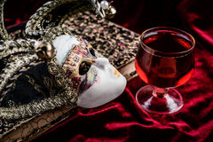 Carnival mask and wine. Theatre decoration concept. Royalty Free Stock Images