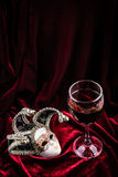 Carnival mask and wine. Theatre decoration concept. Stock Photography