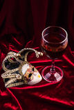 Carnival mask and wine. Theatre decoration concept. Stock Photos