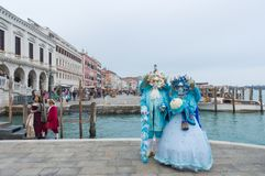 Carnival masked people near Piazza San Marco in Venice stock image