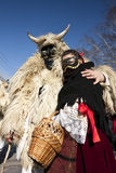 Carnival masker in fur with a 'Sokac' girl at the 'Busojaras', the carnival of winter's funeral Royalty Free Stock Photos