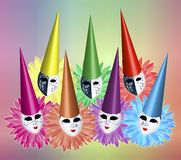 Carnival Masks. Group of seven carnival masks with caps and collars on colourful background Royalty Free Stock Photos