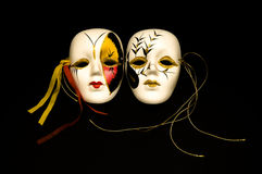 Carnival masks. Two carnival masks isolated on black