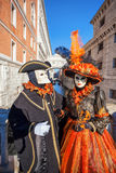 Carnival masks against famous Bridge of Sighs in Venice, Italy Royalty Free Stock Photo