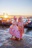 Carnival masks against gondolas in Venice, Italy Royalty Free Stock Photos