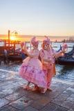 Carnival masks against gondolas in Venice, Italy Royalty Free Stock Image