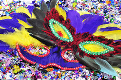 Carnival masks and confetti Stock Photos