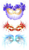 Carnival masks with feathers. Three luxury carnival masks, decorated with elegant decor and fluffy red and blue feathers Royalty Free Stock Image