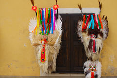 Carnival Masks Hanging On The Wall. Traditional carnival masks kurenti from Ptuj, Slovenia made of ship skins, horns and long red tongues hanging on the wall by Royalty Free Stock Images