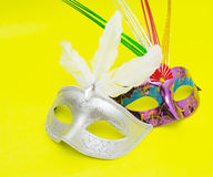 Carnival masks isolated on yellow background Royalty Free Stock Image