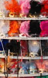 Carnival Masks, Venice. Colourful masks on a market stall ready for carnival goers to buy and wear Stock Image
