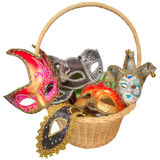 Carnival masks in wicker basket Royalty Free Stock Image
