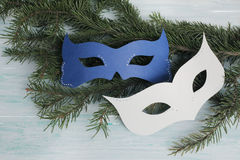 Carnival masks on wooden background with cracks Royalty Free Stock Photos