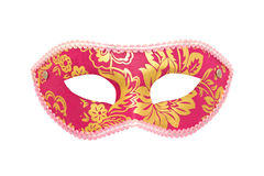 Carnival or masquerade mask. Carnival mask with gold ornament on a white background Stock Image
