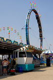 Carnival midway. With many colorful amusement rides royalty free stock photos