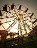 Carnival midway background with Ferris wheel and carousel . Stock Image