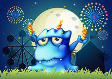 A carnival with a monster with three candles. Illustration of a carnival with a monster with three candles Stock Image