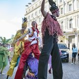 Cuban street performers dancing on stilts, Havana, Cuba royalty free stock images