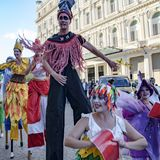 Cuban street performers dancing on stilts, Havana, Cuba stock photos