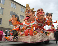 2014 Carnival Parade, Aalst. AALST, BELGIUM, MARCH 03 2014: A trailer full of colorful caricatures, during the annual carnival parade in Aalst, which is a UNESCO Stock Photo