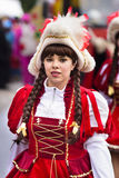 Carnival parade in Bavaria with colorful costums. Bad Hindelang, Germany - Februar 15, 2015: Unknown girl participates at the annual public carnival parade Stock Photo