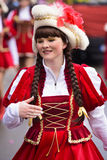 Carnival parade in Bavaria with colorful costums. Bad Hindelang, Germany - Februar 15, 2015: Unknown girl participates at the annual public carnival parade Royalty Free Stock Photo