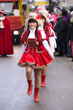 Carnival parade in Bavaria with colorful costums. Bad Hindelang, Germany - Februar 15, 2015: Unknown girl participates at the annual public carnival parade Royalty Free Stock Photos