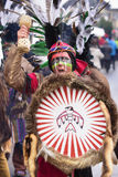 Carnival parade in Bavaria with colorful costums. Bad Hindelang, Germany - Februar 15, 2015: Unknown person participates at the annual public carnival parade Royalty Free Stock Photos