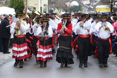 Carnival parade with brass band. Bad Hindelang, Germany - Februar 15, 2015: Unknown persons participate at the annual public carnival parade through the streets Stock Photo