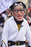 Carnival parade with carved wooden mask. Bad Hindelang, Germany - Februar 15, 2015: Unknown people participate at the annual public carnival parade through the Royalty Free Stock Photography