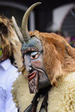 Carnival parade with carved wooden mask. Bad Hindelang, Germany - Februar 15, 2015: Unknown people participate at the annual public carnival parade through the Royalty Free Stock Photo