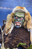 Carnival parade with carved wooden mask. Bad Hindelang, Germany - Februar 15, 2015: Unknown people participate at the annual public carnival parade through the Stock Photos